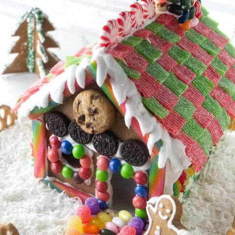 View of roof and front of a decorated gingerbread house.