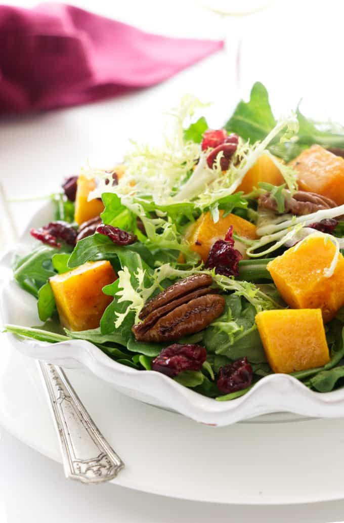 A serving plate with butternut squash salad.