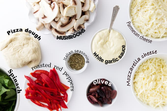 Ingredients needed for mushroom pizza with white garlic sauce.