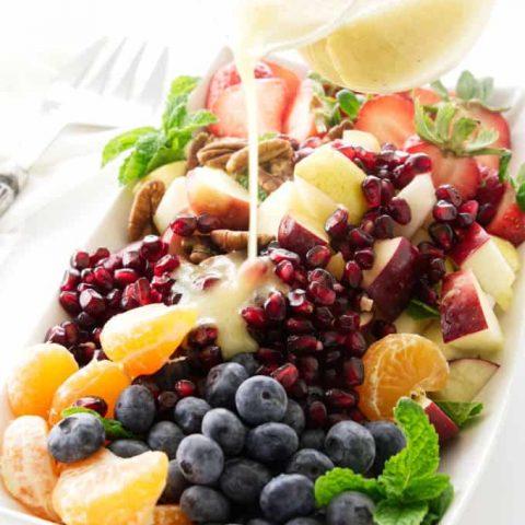 Winter fruit salad with lemon-honey vinaigrette pour