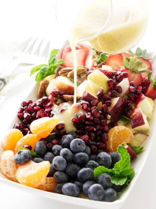 Winter fruit salad with lemon-honey vinaigrette pour