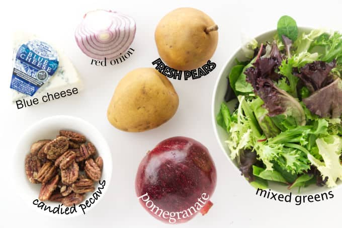Ingredients needed to make a pomegranate pear salad with blue cheese.