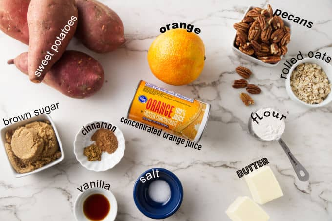 Ingredients used to make sweet potato casserole with pecan streusel and orange juice.