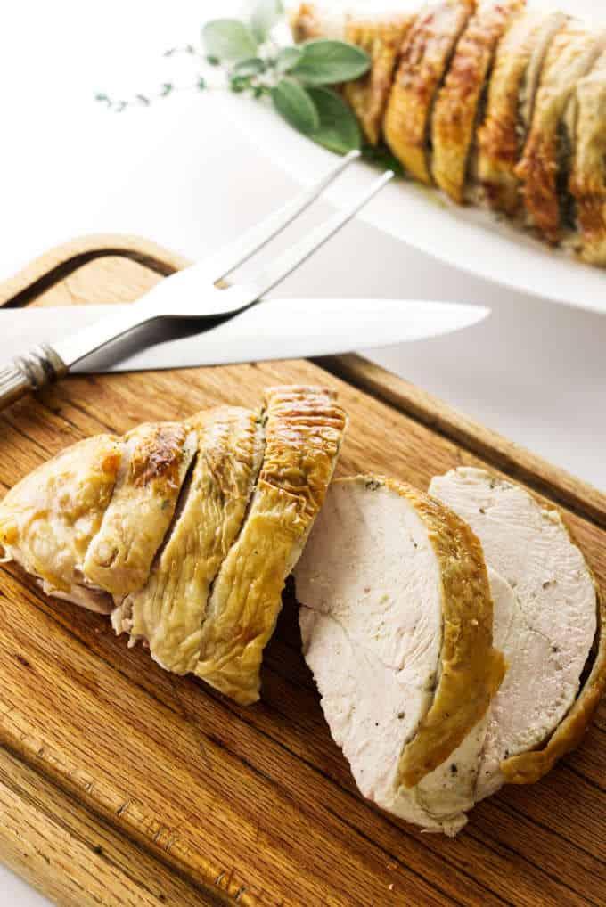 A sliced turkey breast on a cutting board.