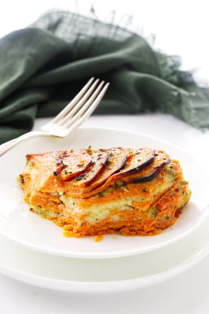 A serving of scalloped sweet potato casserole on a plate.