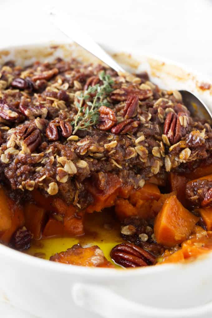 Sweet potato casserole partially scooped out of a dish.