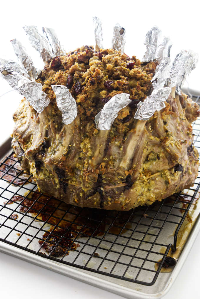 Crown Pork Roast and stuffing on baking rack. Pork bones wrapped with foil