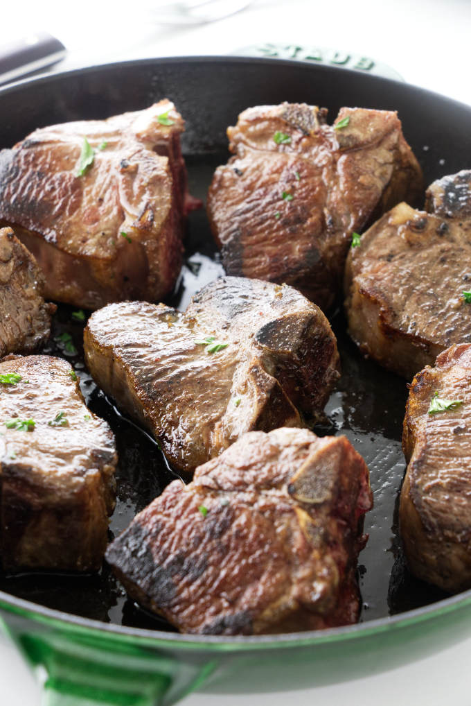 Skillet with seared lamb chops