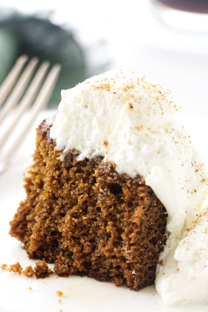 A portion of stout gingerbread cake with fork and napkin in background