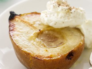 close up photo of a serving of roasted pear with mascarpone cream