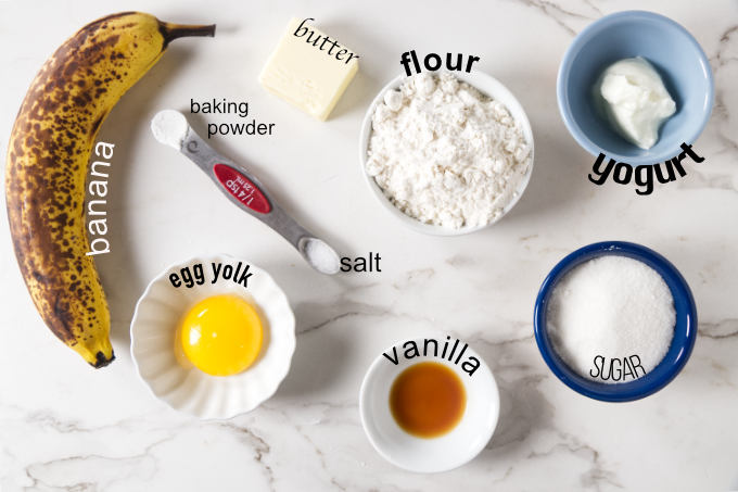 Ingredients needed for banana cake in a mug.