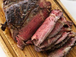 Overhead view of Reverse sear cowboy steak on cutting board