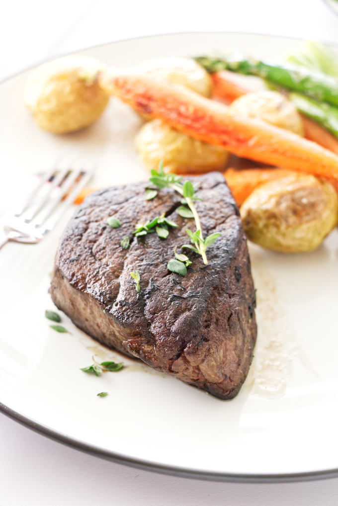 Plated Filet Mignon with roasted potatoes, carrots and asparagus
