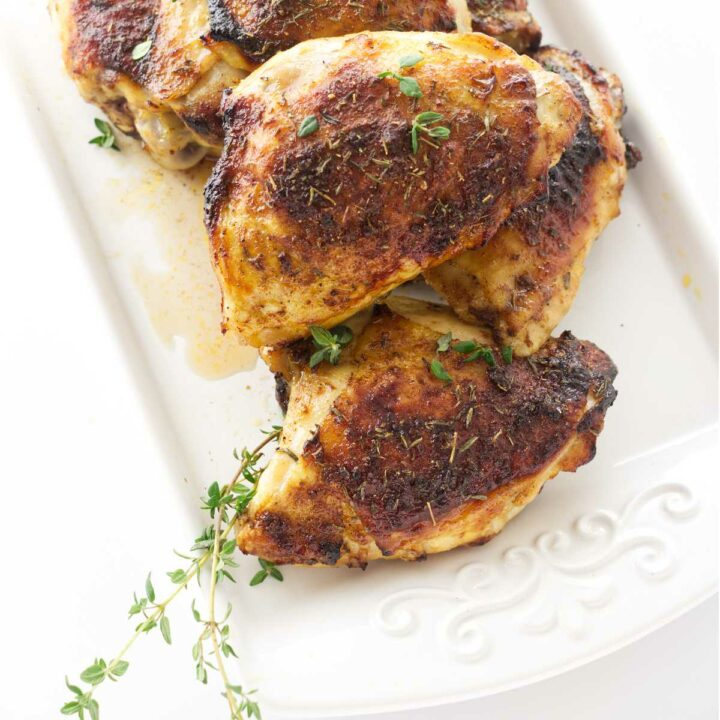 Oven roasted chicken thighs on a plate