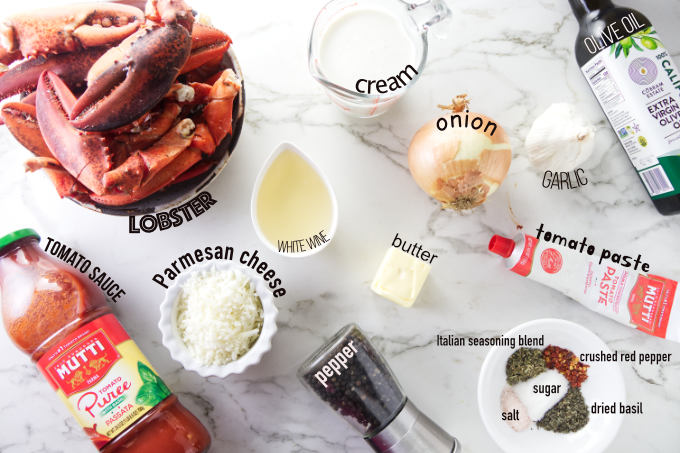 Ingredients needed to make lobster in tomato cream sauce.