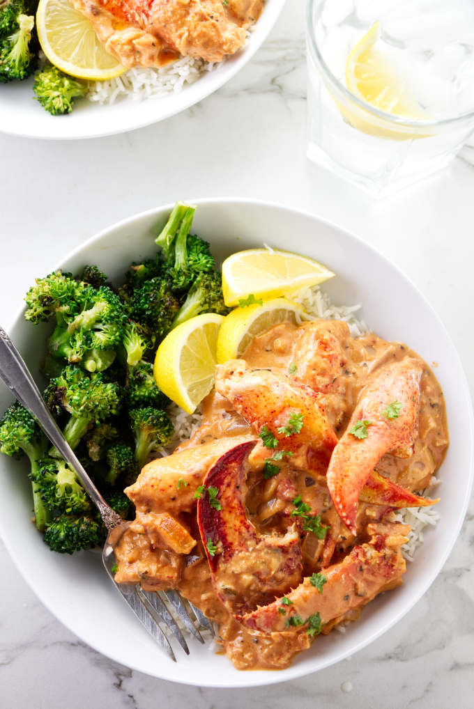 A dish with lobster in tomato cream sauce.