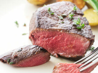 Filet mignon with a bite on a fork