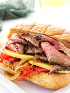 Tri tip sandwich with chipotle aioli on a hoagie roll.