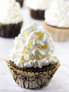 Italian meringue buttercream piped on a cupcake.