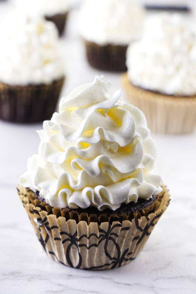 Italian meringue buttercream piped on a cupcake.