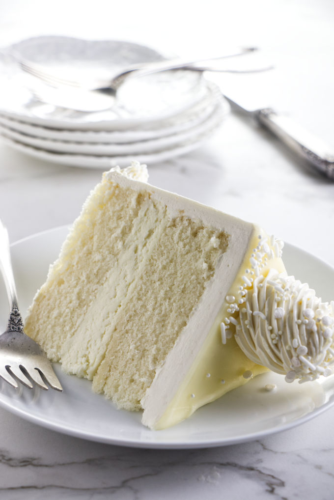 Close up of a slice of white chocolate cake.