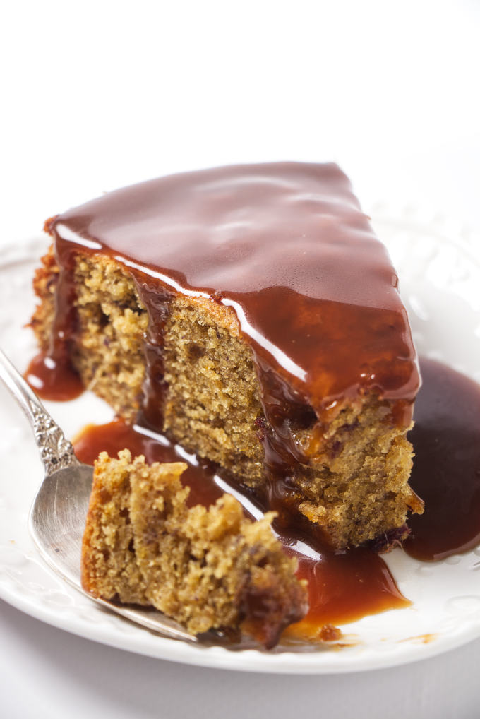 A slice of date cake with toffee sauce.