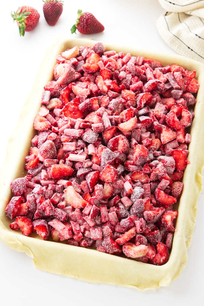 Quarter-size sheet pan with pastry crust and strawberry-rhubarb filling