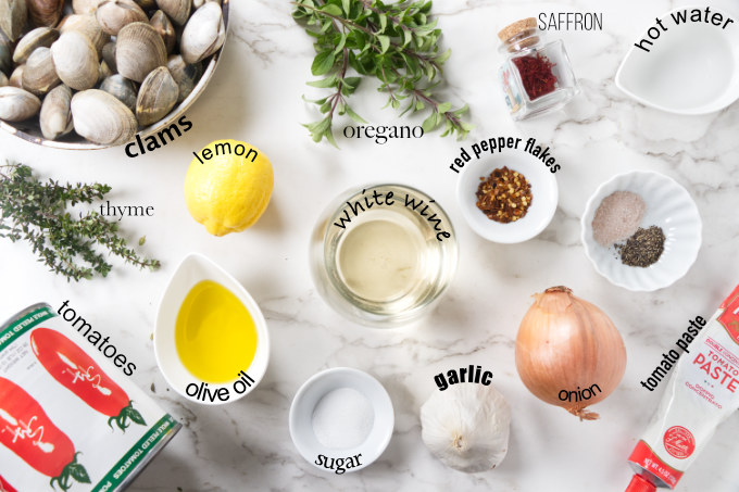 Ingredients needed to make clams in red wine sauce.