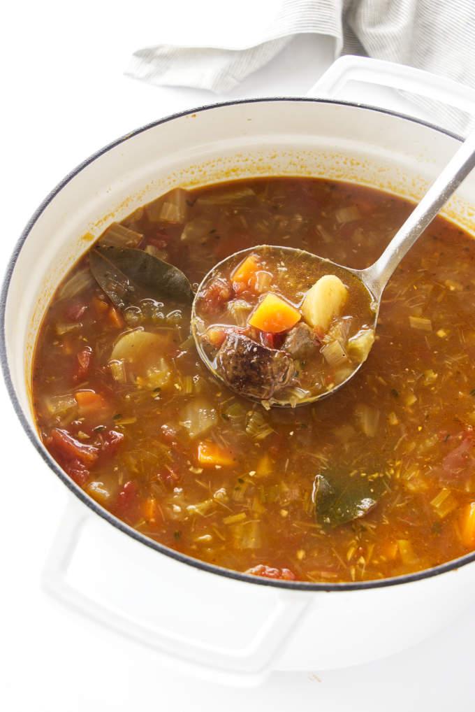 Large pot of soup with a ladle