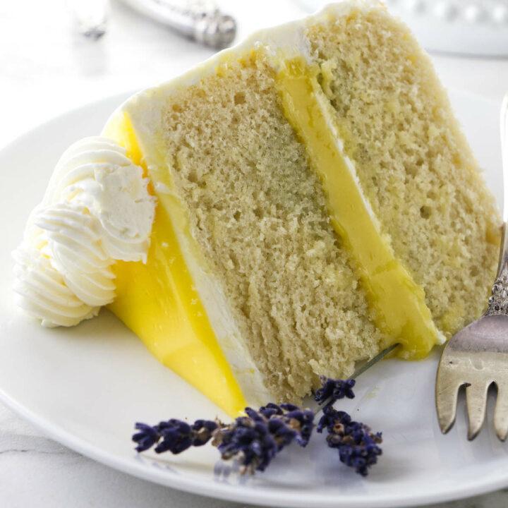 A slice of lemon lavender layer cake. with lemon curd.