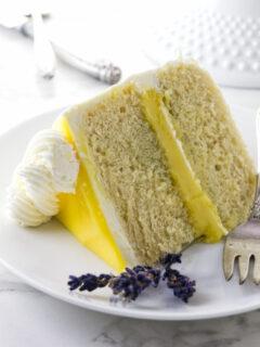 A slice of lemon lavender cake with lemon curd in the center.