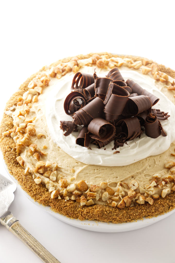 Peanut butter pie with chocolate curls and chopped peanuts.