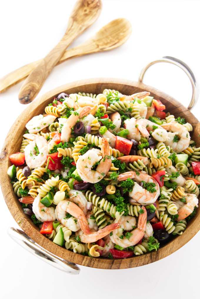 Large salad bowl filled with a pasta salad with shrimp