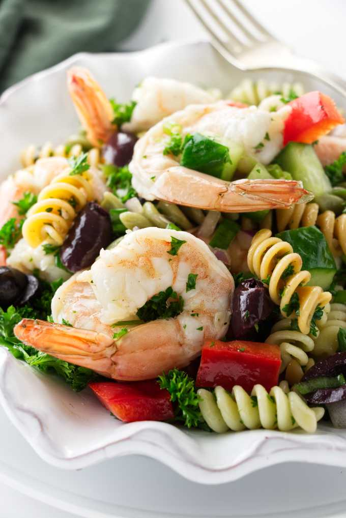 Close up view of a serving of pasta salad with shrimp