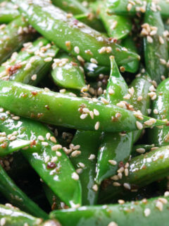 Sesame snap peas with toasted sesame seeds.