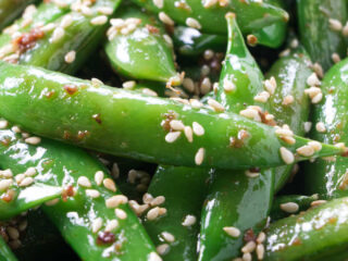 Sesame snap peas with toasted sesame seeds.