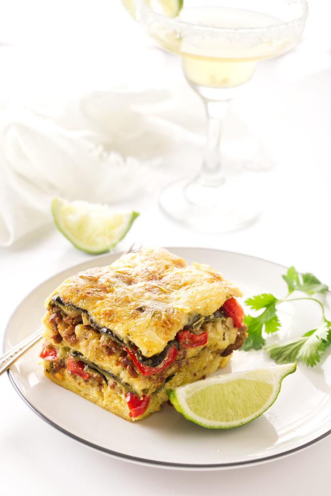 A serving of Poblano-Chorizo Strata, Margarita in the background