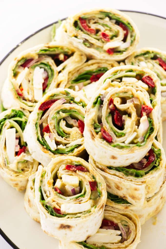Vegetarian Mediterranean pinwheels on a plate.