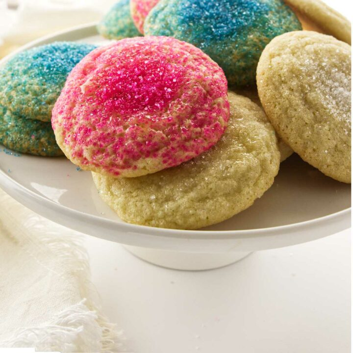 Soft sugar cookies with pink, blue, and white sugar on top.