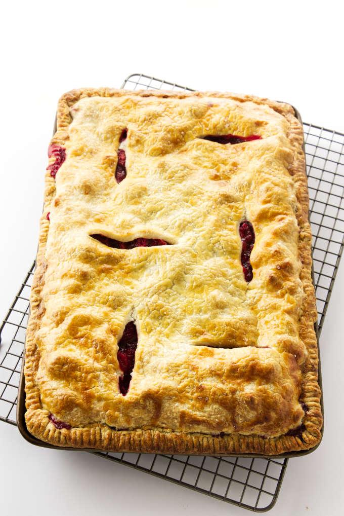 Strawberry-Rhubarb Slab Pie on a cooling rack