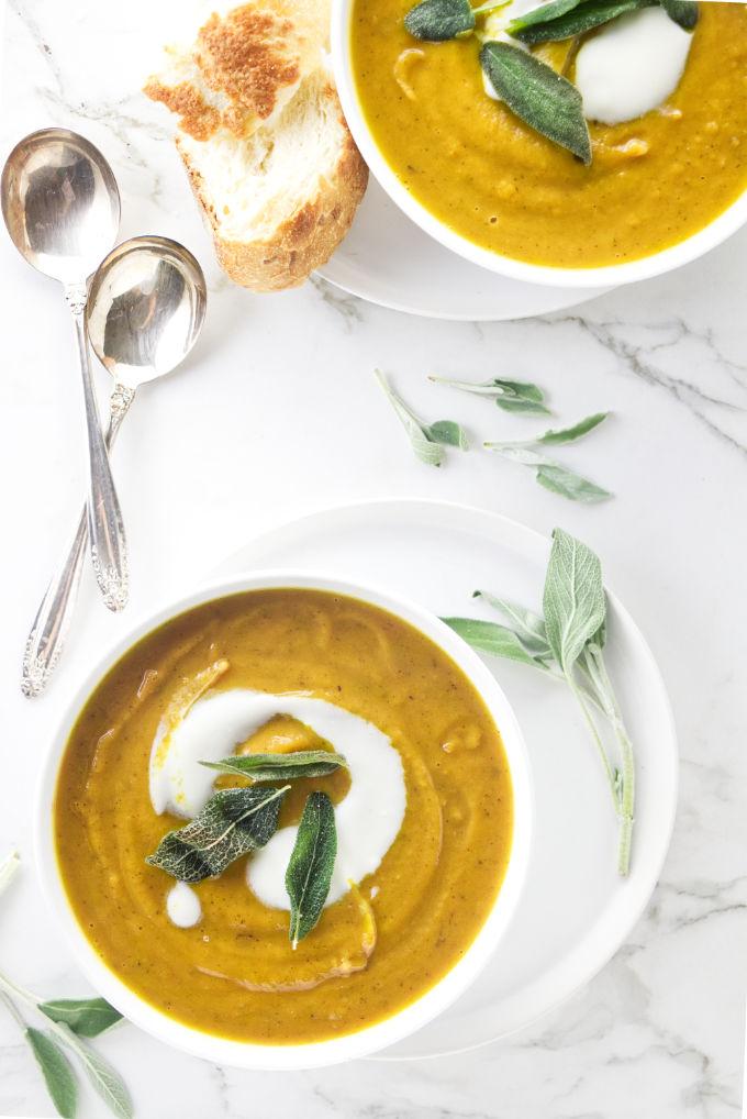 Two bowls of sweet potato sage soup.
