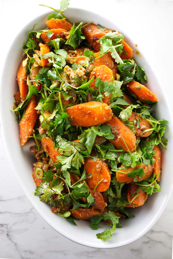 Spicy Moroccan carrot salad in an oval serving dish.