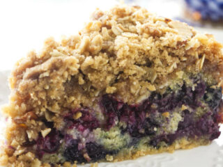 A slice of blueberry buckle cake on a dessert plate.