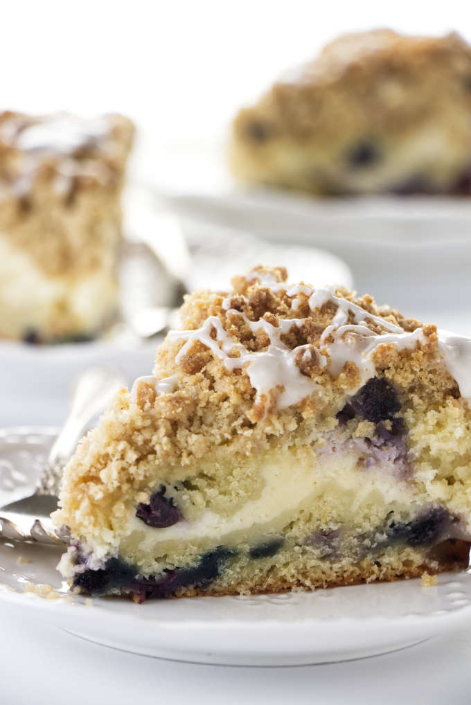 A slice of blueberry coffee cake cheesecake.