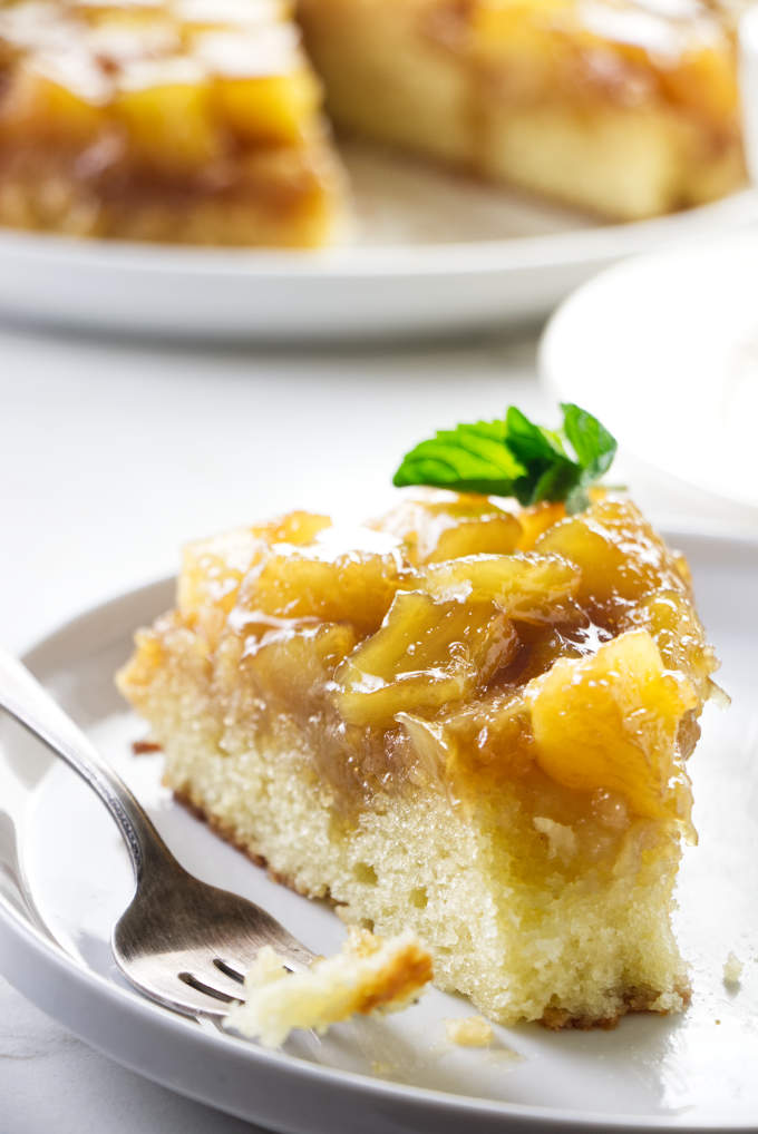 A slice of pineapple cake with a fork.