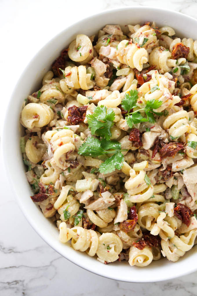 A large salad bowl filled with chicken pasta salad with chipotle dressing.