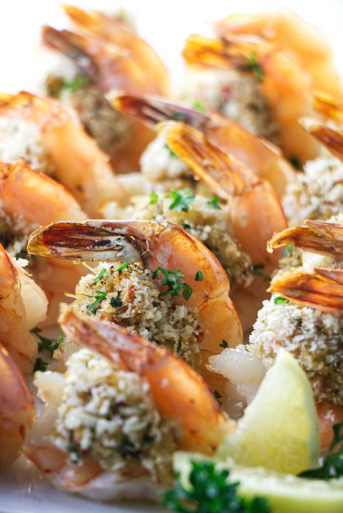 A plate of crab stuffed shrimp placed in rows.