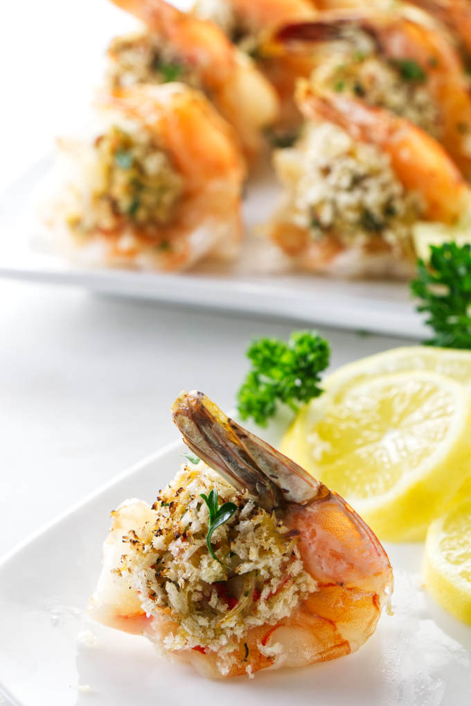 A stuffed shrimp on an appetizer plate.