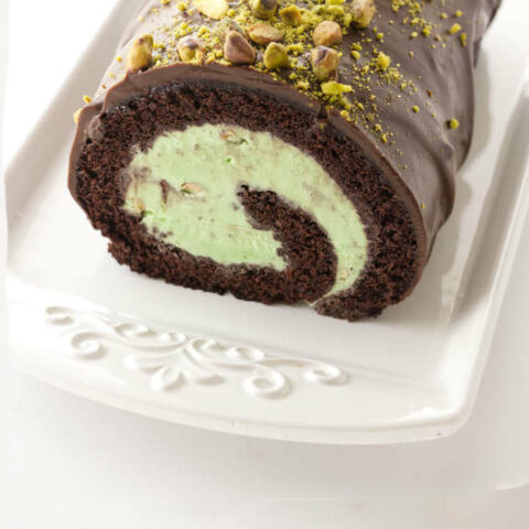Close up view of chocolate and pistachio ice cream cake roll