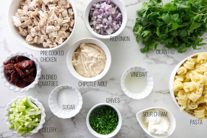 Ingredients needed to make chicken chipotle pasta salad.